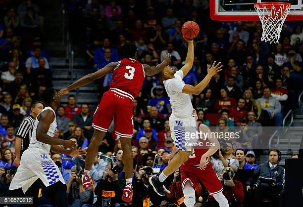 Anunoby of the Indiana Hoosiers fouls Isaiah Briscoe of the Kentucky Wildcats in the second half during the second round of the 2016 NCAA Men's...