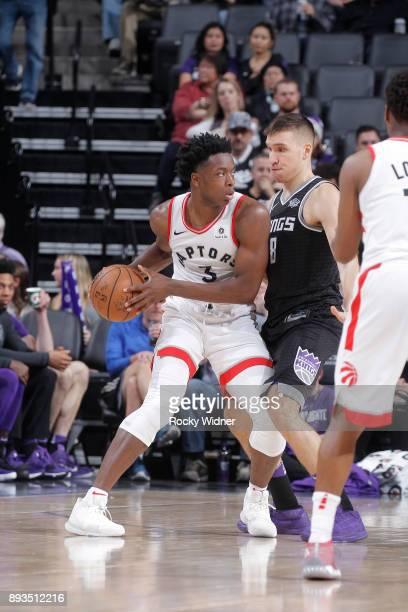 Anunoby of the Toronto Raptors handles the ball against Bogdan Bogdanovic of the Sacramento Kings on December 10 2017 at Golden 1 Center in...