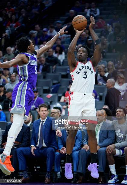 Anunoby of the Toronto Raptors shoots over De'Aaron Fox of the Sacramento Kings during the second half of an NBA basketball game at Golden 1 Center...