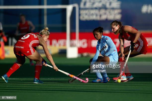 Anupa Barla of India attempts to keep possesion while under pressure from Giselle Ansley of England and Susannah Townsend of England during the...