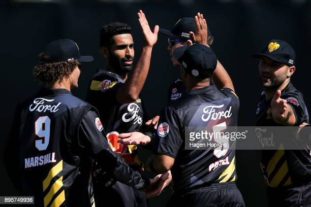 Anurag Verma of the Firebirds celebrates weith teammate Jeetan Patel after taking the wicket of Dean Brownlie of the Knights during the Twenty20...