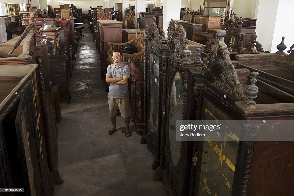 Anusak Parnichyakorn, Owner Of De Siam Colonial And Antique Furniture Store,  Poses Amid Just