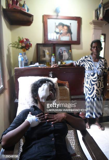 Anusha Kumari 43 wife of a St Sebastian's Church suicide blast victim Dulip Appuhami reacts as she cries in her house in Negombo on April 24 2019 The...