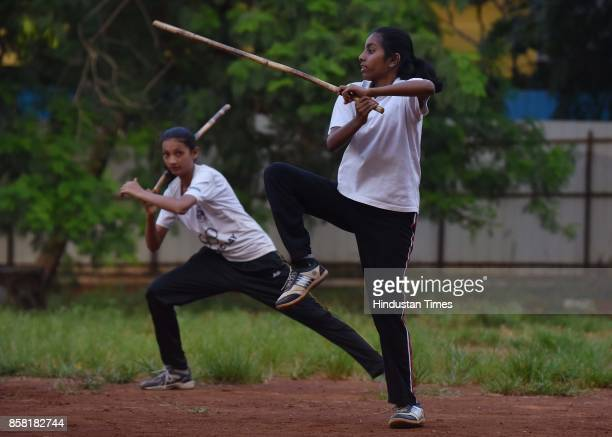 Anushka Mane and Sakshi Patil display Single Stick a type of Silambam a weapon based Indian Martial arts on October 4 2017 in Pune India The word...