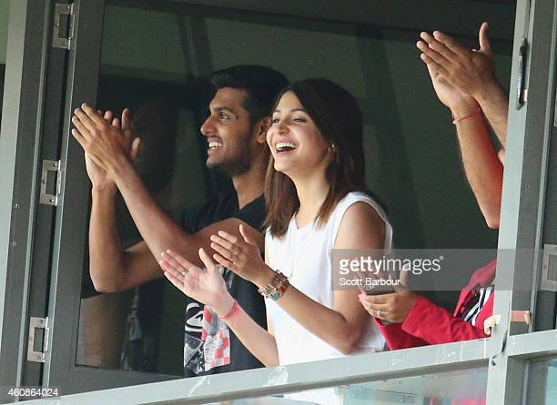 Anushka Sharma girlfriend of Virat Kohli smiles as Kohli celebrates after reaching his century during day three of the Third Test match between...