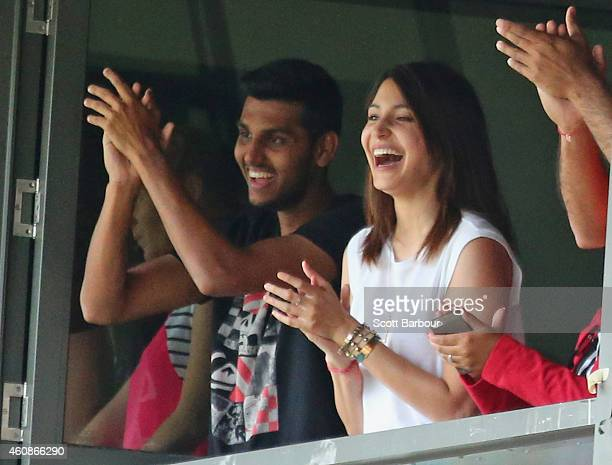 Anushka Sharma girlfriend of Virat Kohli smiles as Kohli celebrates after reaching his century during day three of the Third Test match between...