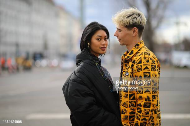 Anuthida Ploypetch and Richy Koll wearing a Balenciaga shirt, Buffalo shoes and Obey jacket and pants on March 07, 2019 in Berlin, Germany.
