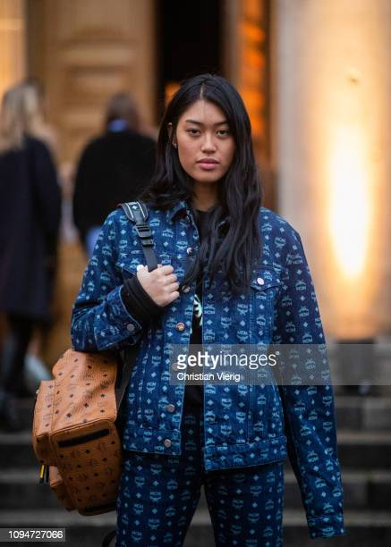 Anuthida Ploypetch is seen weairng MCM denim suit and beige backpack during the Berlin Fashion Week Autumn/Winter 2019 on January 15 2019 in Berlin...