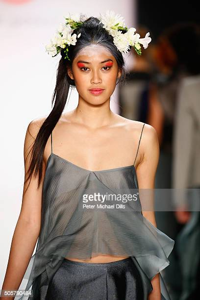 Anuthida Ploypetch walks the runway at the Anja Gockel show during the MercedesBenz Fashion Week Berlin Autumn/Winter 2016 at Brandenburg Gate on...