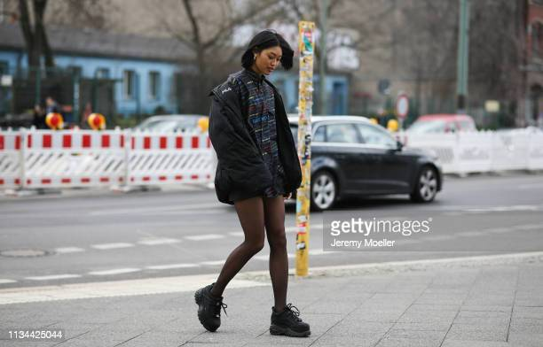Anuthida Ploypetch wearing a Balenciaga shirt and Buffalo shoes on March 07, 2019 in Berlin, Germany.