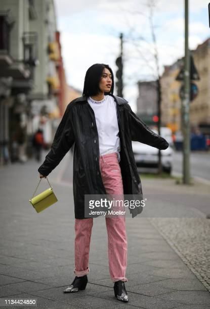 Anuthida Ploypetch wearing an Acne Studios shirt Off White jeans and leather jacket on March 07 2019 in Berlin Germany
