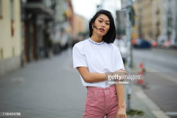 Anuthida Ploypetch wearing an Acne Studios shirt Off White jeans on March 07 2019 in Berlin Germany