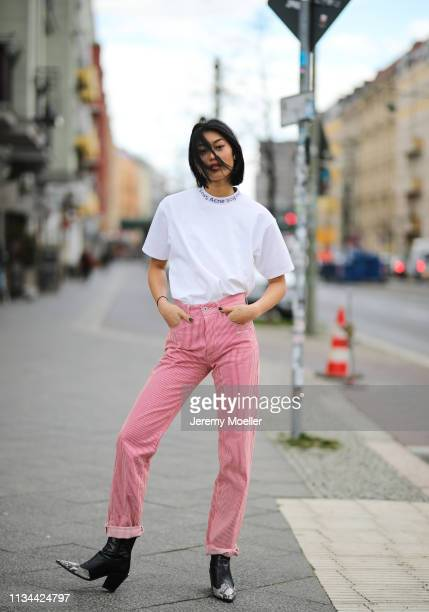 Anuthida Ploypetch wearing an Acne Studios shirt, Off White jeans on March 07, 2019 in Berlin, Germany.