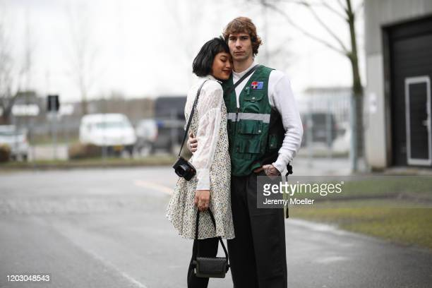 Anuthida Ploypetch wearing Lala Berlin dress and bag and Richy Koll before LalaBerlin on January 30, 2020 in Copenhagen, Denmark.