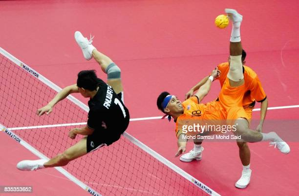Anuwat Chaicana of Thailand blocks a ball during the Sepak Takraw Men's competition against Malaysia at the 2017 SEA Games on August 19 2017 in Kuala...