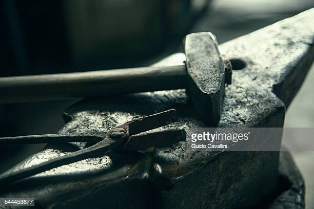 Anvil, hammer, tong