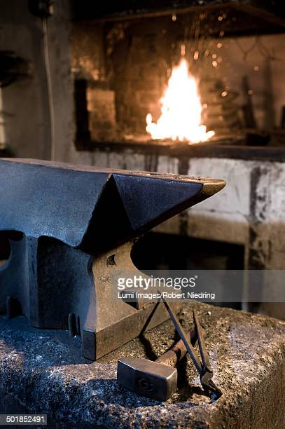 Anvil, tools and a forge in blacksmith shop, Landshut, Bavaria, Germany
