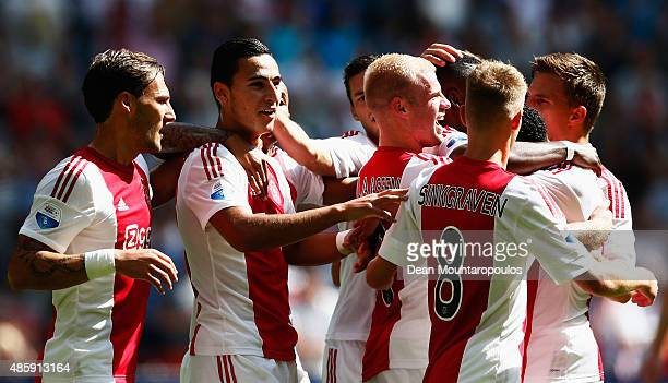 Anwar El Ghazi of Ajax celebrates scoring his teams first goal of the game with team mates during the Dutch Eredivisie match between Ajax Amsterdam...