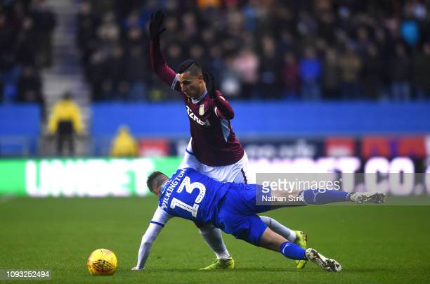 Anwar El Ghazi of Aston Villa and Anthony Pilkington of Wigan Athletic in action during the Sky Bet Championship match between Wigan Athletic and...