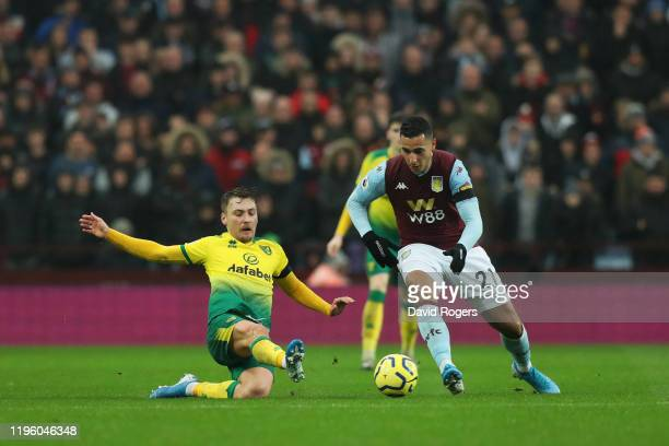 Anwar El Ghazi of Aston Villa battles for the ball with Tom Trybull of Norwich City during the Premier League match between Aston Villa and Norwich...