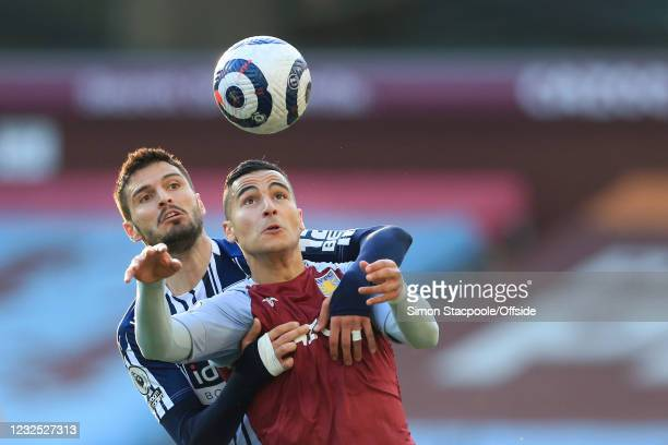 Anwar El Ghazi of Aston Villa battles with Okay Yokuslu of West Bromwich Albion during the Premier League match between Aston Villa and West Bromwich...
