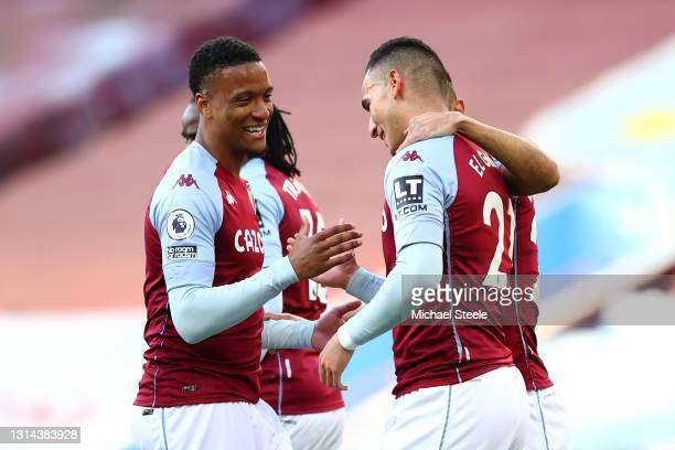 Anwar El Ghazi of Aston Villa celebrates after scoring their team's first goal with Ezri Konsa of Aston Villa during the Premier League match between...