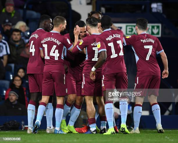 Anwar El Ghazi of Aston Villa celebrates with his team after scoring their second goal during the Sky Bet Championship match between West Bromwich...