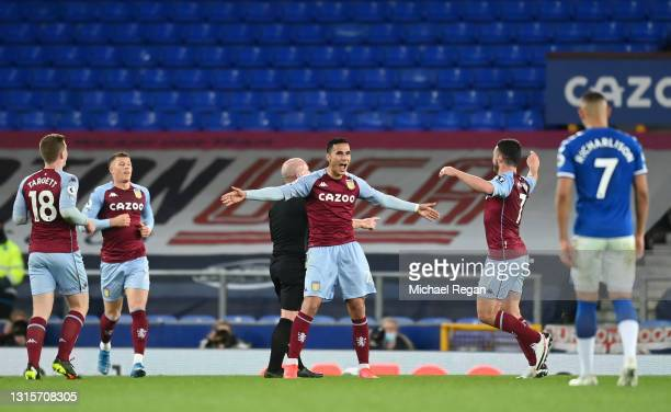 Anwar El Ghazi of Aston Villa celebrates with John McGinn after scoring their side's second goal during the Premier League match between Everton and...