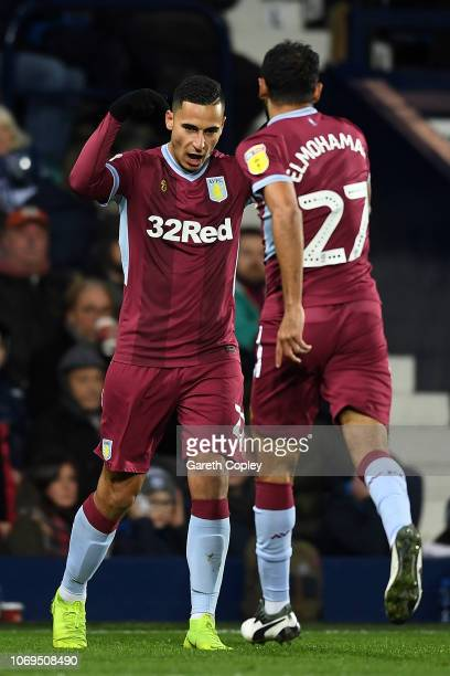Anwar El Ghazi of Aston Villa celebrates with team mate Ahmed Elmohamady after scoring their second goal during the Sky Bet Championship match...