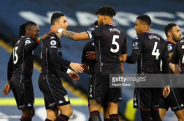 Anwar El Ghazi of Aston Villa celebrates with teammates Bertrand Traore and Tyrone Mings after scoring his team's first goal during the Premier...