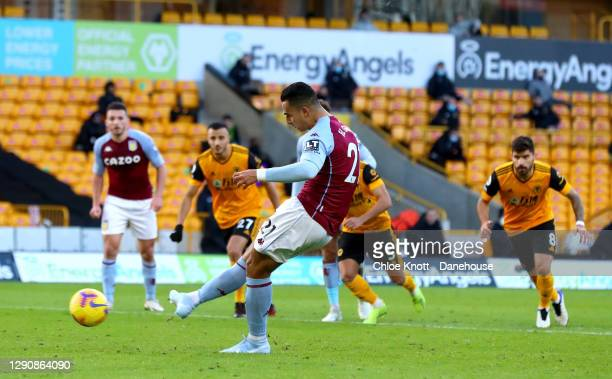 Anwar El Ghazi of Aston Villa scores a penalty for his team during the Premier League match between Wolverhampton Wanderers and Aston Villa at...