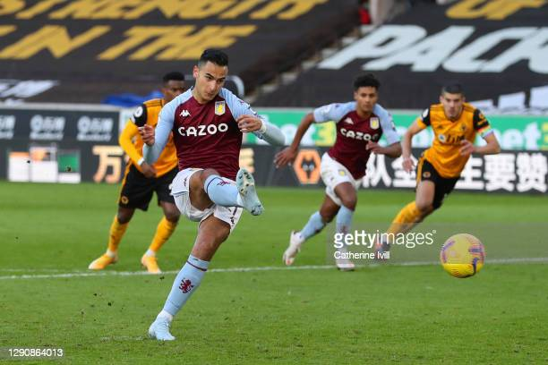Anwar El Ghazi of Aston Villa scores a penalty for his team's first goal during the Premier League match between Wolverhampton Wanderers and Aston...