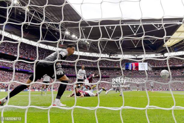 Anwar El Ghazi of Aston Villa scores his sides first goal past Kelle Roos of Derby County during the Sky Bet Championship Playoff Final match between...