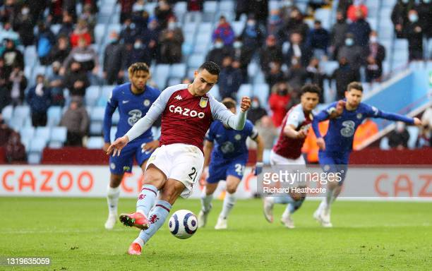 Anwar El Ghazi of Aston Villa scores their side's second goal from the penalty spot during the Premier League match between Aston Villa and Chelsea...