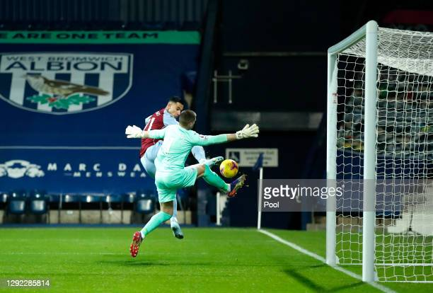 Anwar El Ghazi of Aston Villa scores their team's first goal as Sam Johnstone of West Bromwich Albion attempts to save during the Premier League...