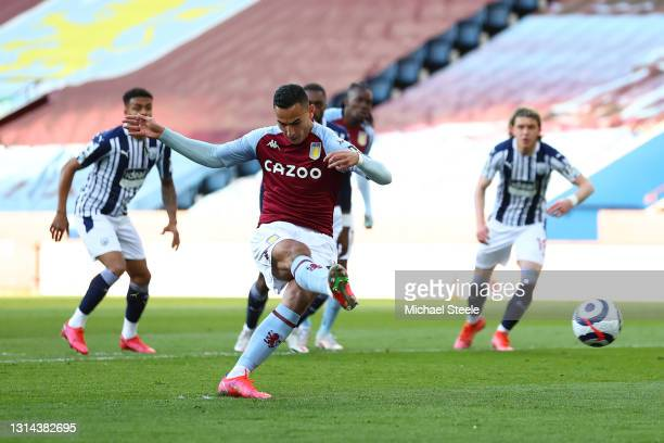 Anwar El Ghazi of Aston Villa scores their team's first goal from the penalty spot during the Premier League match between Aston Villa and West...