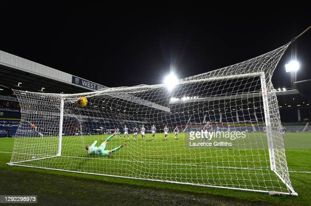 Anwar El Ghazi of Aston Villa scores their team's third goal from the penalty spot as Sam Johnstone of West Bromwich Albion attempts to save during...