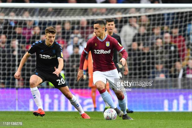 Anwar El Ghazi of Aston Villa with Middlesbrough defender Dael Fry looking to make a tackle during the Sky Bet Championship match between Aston Villa...