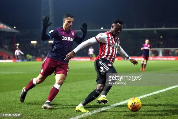 Anwar ElGhazi of Aston Villa closes down Moses Odubajo of Brentford during the Sky Bet Championship match between Brentford and Aston Villa at...