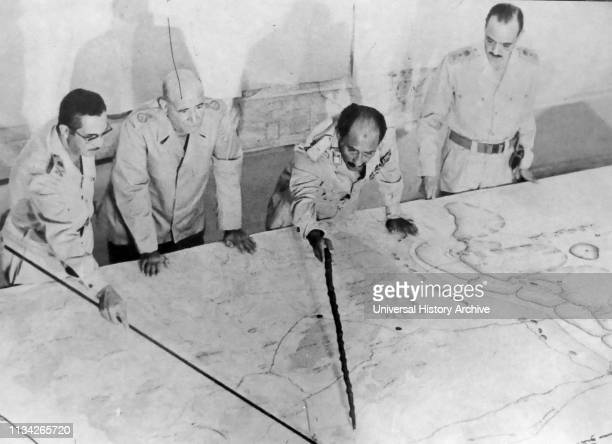Anwar el-Sadat President of Egypt. At Military HQ during the 1973 Arab-Israeli War. He is accompanied by Field Marshall Ahmed Ismail and General...