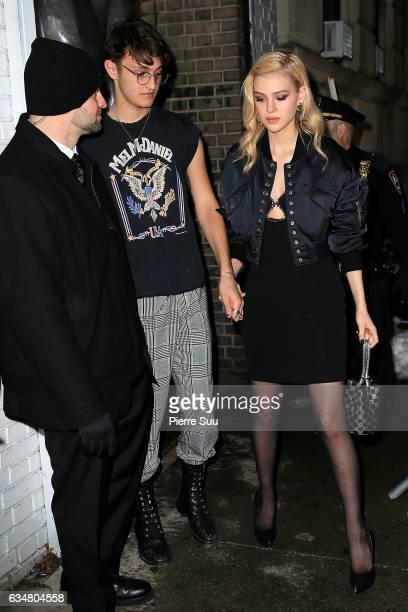 Anwar Hadid and Nicola Peltz leave the Alexander Wang February 2017 fashion show during New York Fashion Week on February 11 2017 in New York City