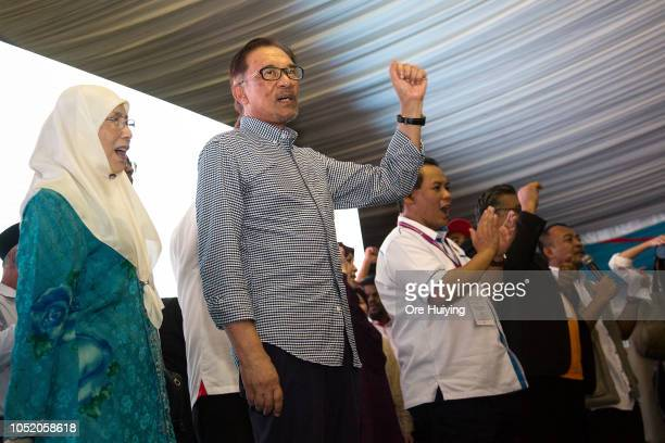 Anwar Ibrahim celebrates his victory of the byelection with his supporters outside the party's headquarters on October 13 2018 in Port Dickson...