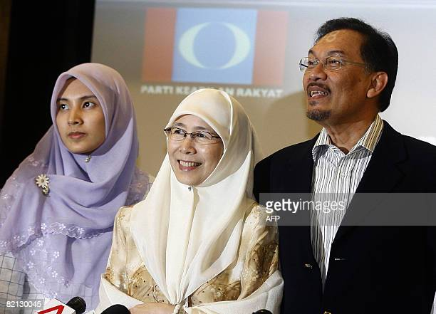 Anwar Ibrahim daughter Nurul Izzah and wife Wan Azizah pose during a press conference at the People's Justice Party headquarters in Petaling Jaya...
