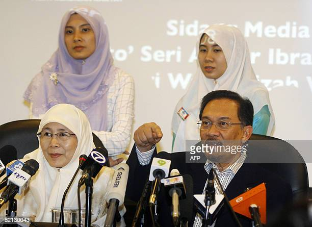 Anwar Ibrahim daughter Nurul Izzah wife Wan Azizah and daughter Nurul Nuha pose during a press conference at the People's Justice Party headquarters...
