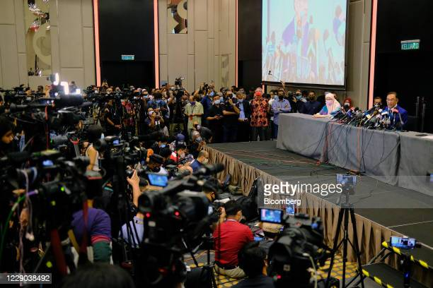 Anwar Ibrahim founder and president of the People's Justice Party right attends a news conference in Kuala Lumpur Malaysia on Tuesday Oct 13 2020...