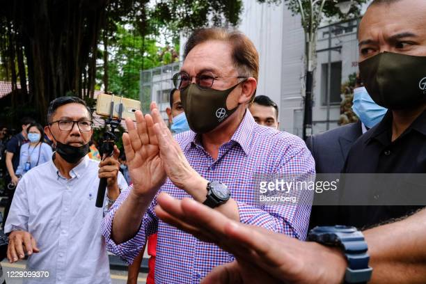 Anwar Ibrahim founder and president of the People's Justice Party speaks during a news conference outside the Bukit Aman police headquarters in Kuala...