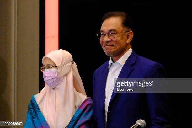 Anwar Ibrahim founder and president of the People's Justice Party right and Wan Azizah Wan Ismail Malaysia's former deputy prime minister attend a...