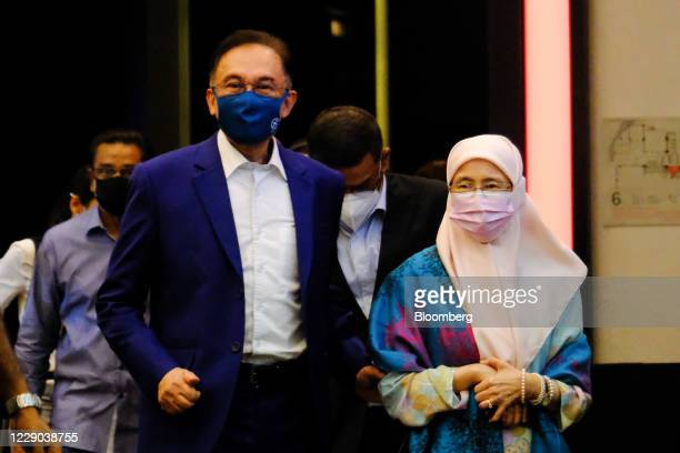 Anwar Ibrahim founder and president of the People's Justice Party left and Wan Azizah Wan Ismail Malaysia's former deputy prime minister arrive for a...