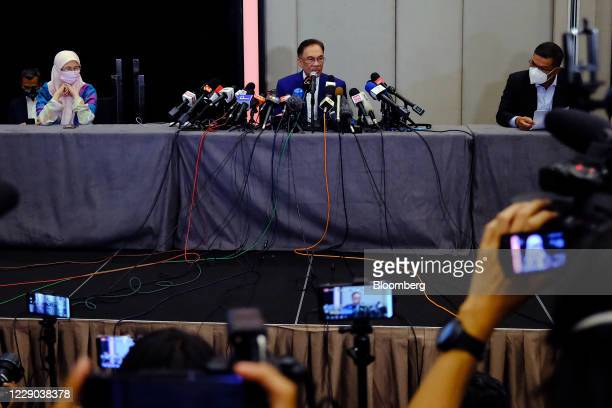 Anwar Ibrahim founder and president of the People's Justice Party seated middle and Wan Azizah Wan Ismail Malaysia's former deputy prime minister...