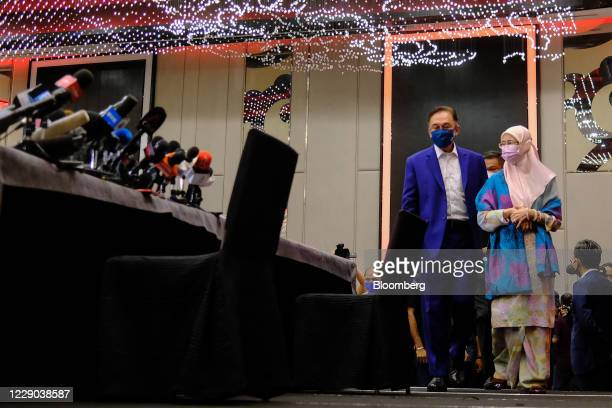 Anwar Ibrahim founder and president of the People's Justice Party center left with Wan Azizah Wan Ismail Malaysia's former deputy prime minister...